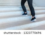 close up legs men are walking... | Shutterstock . vector #1323770696