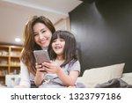 portrait happy daughter playing ... | Shutterstock . vector #1323797186