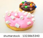 two donuts isolated on the... | Shutterstock . vector #1323865340