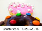 two donuts isolated on the... | Shutterstock . vector #1323865346