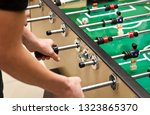 guys are  playing table soccer... | Shutterstock . vector #1323865370