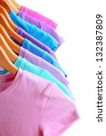 lots of t shirts on hangers... | Shutterstock . vector #132387809