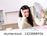 young woman with receipts in... | Shutterstock . vector #1323888956