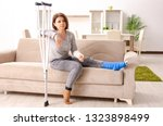 woman after car accident... | Shutterstock . vector #1323898499