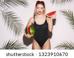 cute girl with red lips wearing ... | Shutterstock . vector #1323910670