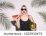 attractive girl with red lips... | Shutterstock . vector #1323910673
