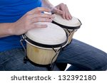 Man's Hands Playing Bongos On...