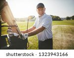 smiling senior man standing by... | Shutterstock . vector #1323943166
