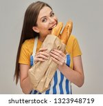 woman eating bread baguette... | Shutterstock . vector #1323948719