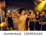 cheerful friends partying in a... | Shutterstock . vector #1324031633
