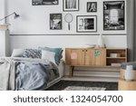 unique wooden cabinet next to... | Shutterstock . vector #1324054700
