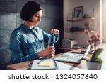 woman wearing denim shirt... | Shutterstock . vector #1324057640