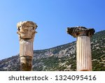 columns of an ancient temple in ... | Shutterstock . vector #1324095416