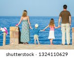 happy parents with children... | Shutterstock . vector #1324110629
