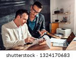 two businessman consulting... | Shutterstock . vector #1324170683