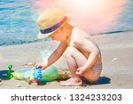 happy child playing on the sea... | Shutterstock . vector #1324233203