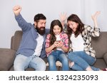 happy family at home. little... | Shutterstock . vector #1324235093