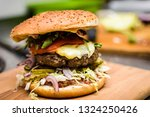 burger with oscypek cheese in a ... | Shutterstock . vector #1324250426