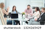business team discussing the... | Shutterstock . vector #1324265429