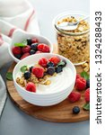 plain yougurt with granola and... | Shutterstock . vector #1324288433