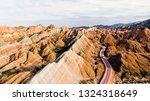 top view of rainbow mountains... | Shutterstock . vector #1324318649