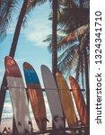 Many Surfboards Beside Coconut...