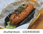 hot dog with charcoal bread  it'... | Shutterstock . vector #1324403030