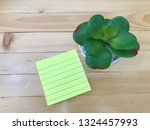 paper note and small tree on... | Shutterstock . vector #1324457993