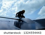 installing a solar cell on a... | Shutterstock . vector #1324554443