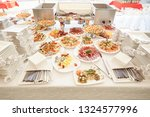 buffet table with a variety of... | Shutterstock . vector #1324577996