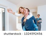man carrying his wife piggyback ...   Shutterstock . vector #1324592456