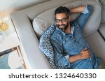 Mature Man Resting On Sofa And...