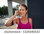 Mature Woman Runner Wearing...