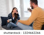 loving couple sitting together... | Shutterstock . vector #1324662266