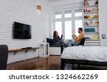 loving couple sitting together... | Shutterstock . vector #1324662269