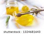 honey in glass jar on white... | Shutterstock . vector #1324681643