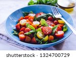 fresh bright tomato salad from... | Shutterstock . vector #1324700729