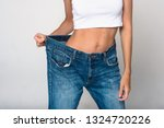 diet concept and weight loss.... | Shutterstock . vector #1324720226
