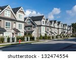 A Row Of A New Townhouses In...