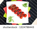 a bunch of cherry tomatoes laid ... | Shutterstock . vector #1324788443