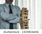 business man tower  risk concept | Shutterstock . vector #1324816646