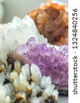 Small photo of Collection of crystals, minerals and fossils. Druse of amethyst, quartz, rhinestone and aragonite.
