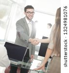 close up. the handshake of... | Shutterstock . vector #1324981076