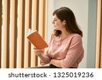 smiling woman thinking over the ... | Shutterstock . vector #1325019236