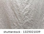 texture wrinkled white fabric.... | Shutterstock . vector #1325021039