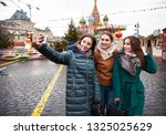 three happy beautiful... | Shutterstock . vector #1325025629