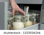 women picking an item from... | Shutterstock . vector #1325036246