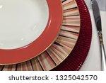 empty elegant table set from... | Shutterstock . vector #1325042570