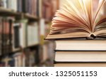 old stacked books on blurred... | Shutterstock . vector #1325051153