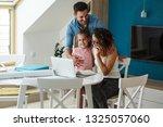 happy family in living room.... | Shutterstock . vector #1325057060